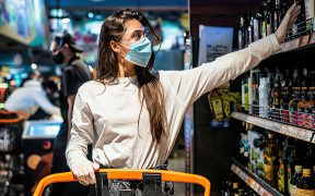 Woman shopping with surgical mask